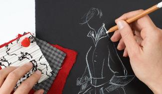 hand drawing a fashion sketch